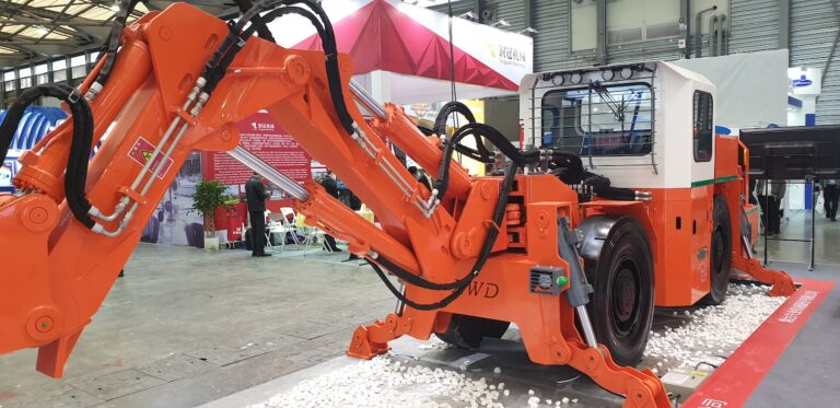 an excavator that is protected with a protecfire fire supression system on an exhibition stall